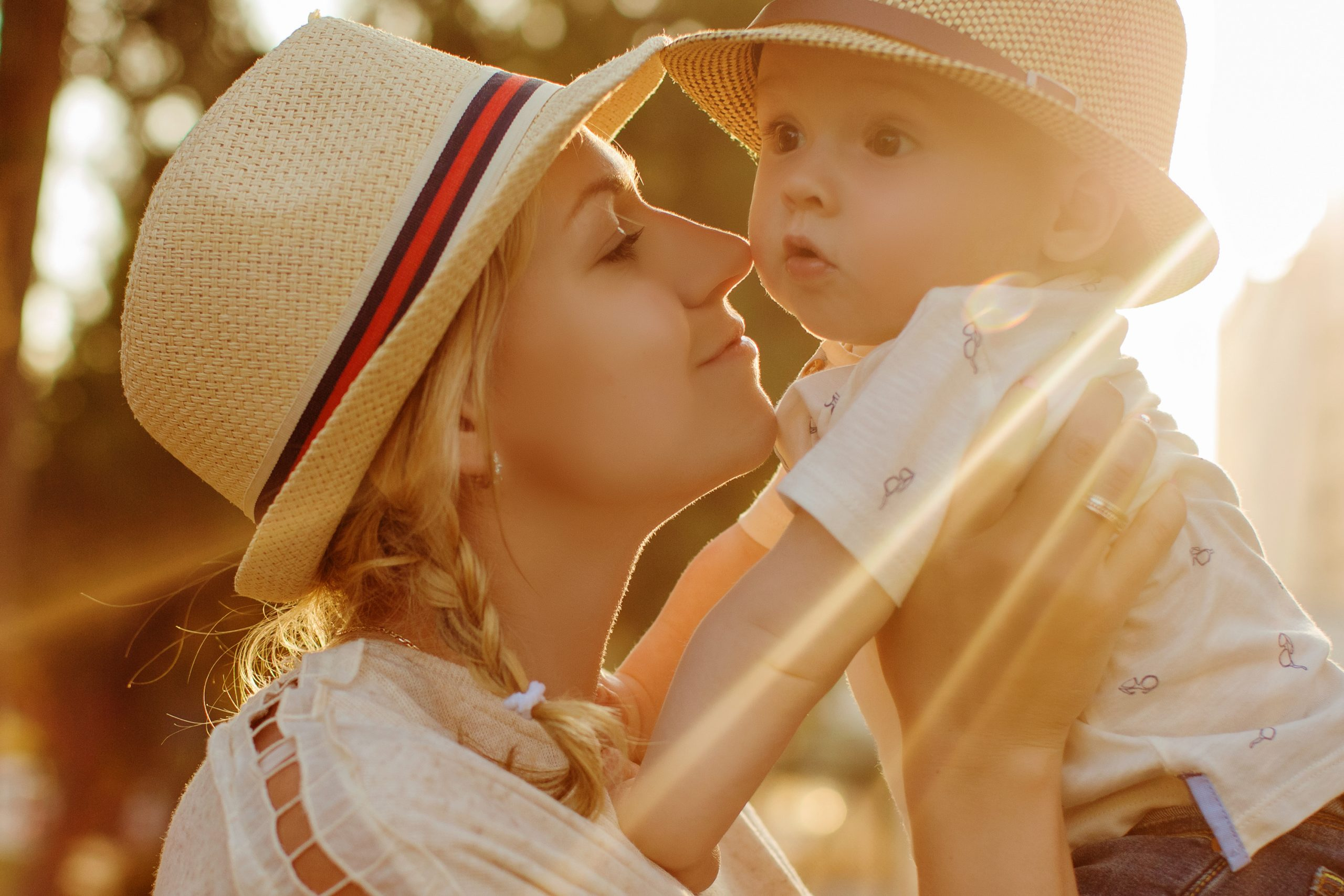 Beautiful,Blonde,In,A,Hat,Mother,Kissing,Her,Son,At